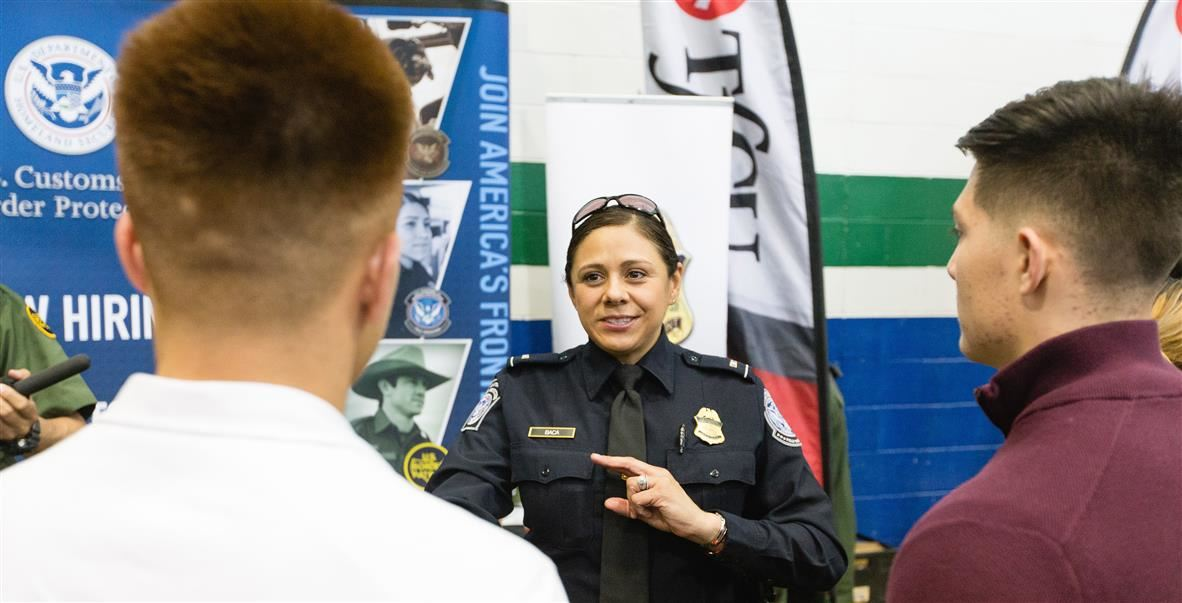 Border Patrol agent speaking to students