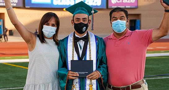Pebble Hills High School graduate and parents celebrating