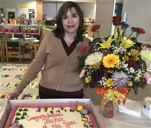 Quezada receives recognition for teacher of the year. Photo.