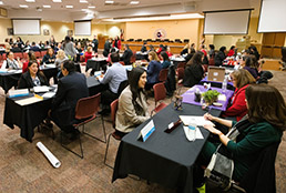 Image of room filled with applicants and interviewers