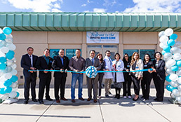 SISD staff cutting ribbon at Employee Health Clinic