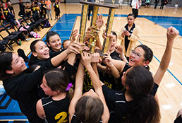 Group photo of PDN girls basketball holding trophy